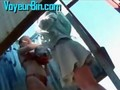 Two women changing in a beach cabin on hidden cam