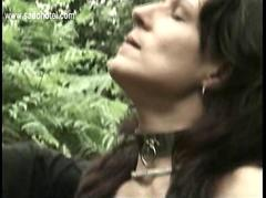 Slave with nice tits sucks cock of her master in the woods while her husband jerksoff until he cums
