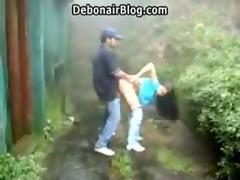 Horny Indian college couple sucking and fucking standing and doggy style outdoors MMS