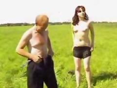 Young redhead girl sucking homeless guy dick
