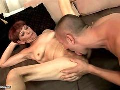 Old redhead gets her hairy pussy fucked by a stud