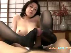 Busty Asian Milf In Stockings Giving Footjob and Sucking