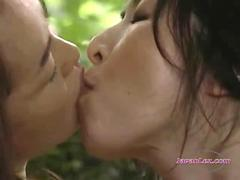 2 Asian Women Fucking With Strapon Kissing Licking Pussies In The Roo