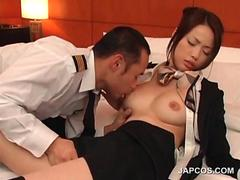 Stockinged Japanese flight attendant gets her tits licked