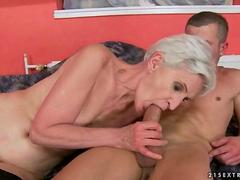 Granny in black stockings enjoys hard sex with a younger dude