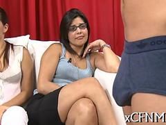 Clothed gals watch a wanking contest