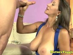 Busty brunette cougar tugging his cock