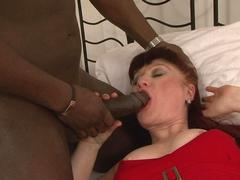 Nasty black fucker jams his big black cock deep inside a dirty white granny
