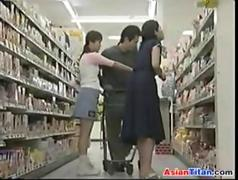 Asian MILF gets fucked in a public bathroom