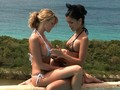 Two bikini chicks fisting each other out in the sun