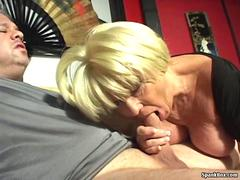 Busty blonde gives head while smoking