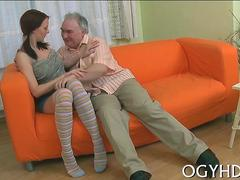 Hot brunette angel gets seduced and fucked by disgusting old man on a couch