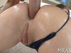 her oiled up ass getting fucked with a smooth cock
