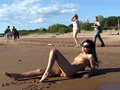 nudist girls splashing around and playing in shallow water segment