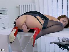Blonde office slut teases up skirt in nylon suspenders slips panties off and wanks in stilettos