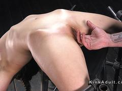 Kinky hottie gets tied up to a machine for her fetish satisfaction and gets abused