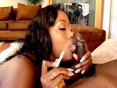 Sublime black wench Aryana Starr smokes and gives fellatio