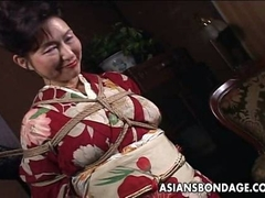 Asian mature bitch has a rope session to endure