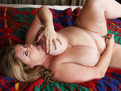 Shaved BBW mature toying herself