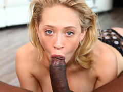 A blonde cutie receives a huge black shaft deeply in her mouth